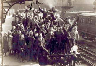 Jack Sims indicated on this group photo in UK ready to embark on his ship to New Zealand. Photo probably at at Southampton docks.