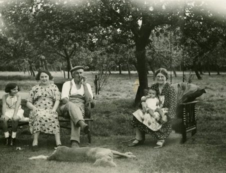 Rear of 'Orchardville', Daws Heath Road. From left: Sheila Chalk, next Rose Chalk, Herbert Angelo Chalk, Alice Jane Chalk with Gillian Anne Chalk on her knee. The dog was also called Sheila. | Gill and Colin Blackall