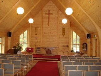 A view inside the church showing all fittings, carpet and chairs, ready for worship. | Ken Jones