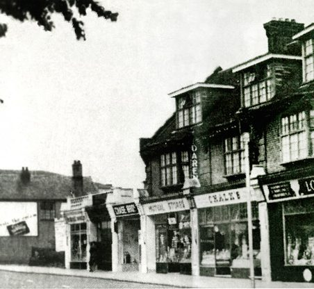From right to left: The Co-op grocery; Chalks, No. 8 Central Parade, now 239 London Road (The Salvation Army Shop); Mutual Stores groceries; Chase Brothers corn chandlers; Pettens jewellers; Howard Dairies and a seat for the elderly, before Sharps the opticians. | Gill and Colin Blackall