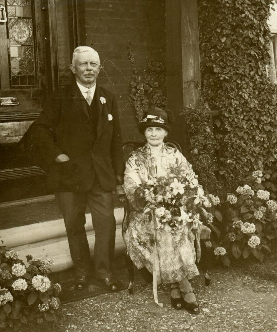 Alfred & Sarah Hawks on their Golden Wedding outside Holbro House | Ian Hawks