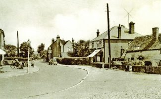 The shops between the White Hart and the old Hart Cottages | H.& T. C. Archive