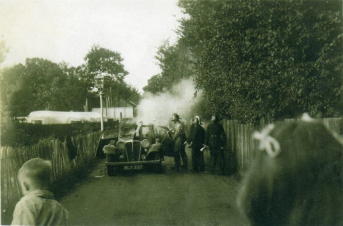 It is difficult to place now, but this photo by Ian Hawks shows the Hadleigh Fire Brigade attending a car fire at the top of Castle Lane in 1949. Nothing is recognizable. How Castle Lane has changed… | Ian Hawks