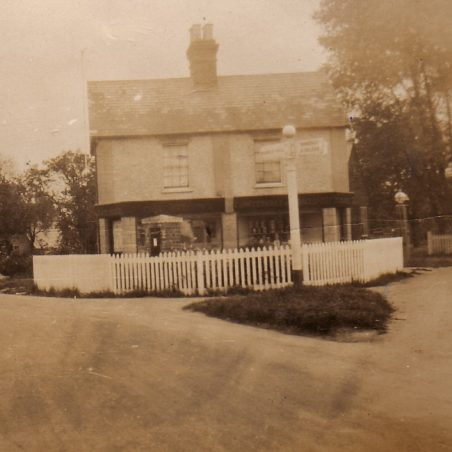 'Clarkes Corner Off Licence and garage to the right.