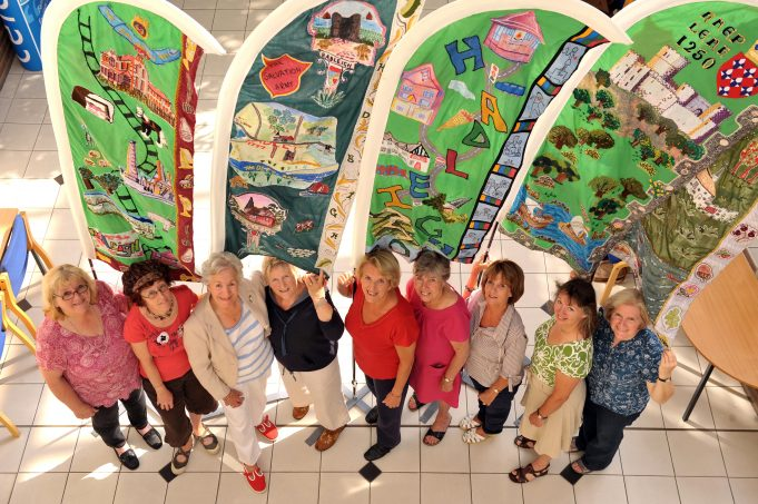 The needlewomen of Team Hadleigh with the finished textiles at CPBC offices, Thundersley | Team Hadleigh