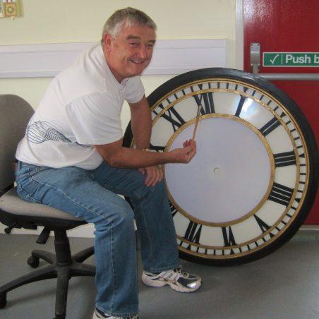 Brian restoring the clock face | Lynda Manning