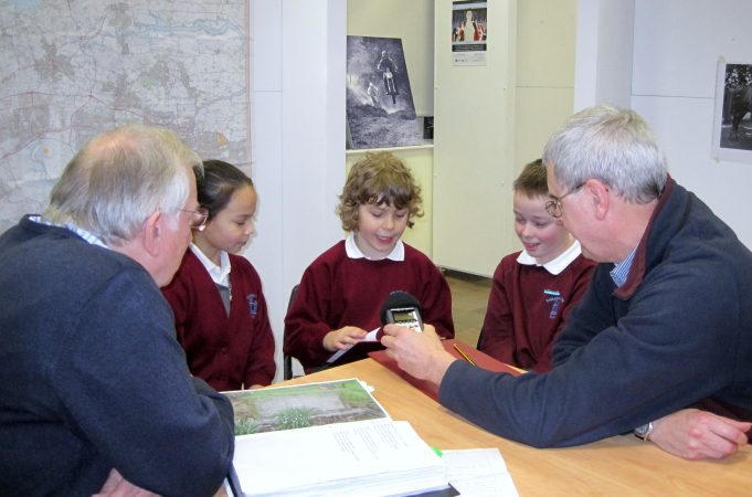 At Hadleigh Old Fire Station - Graham Cook and David Hurrell, Editors at Hadleigh & Thundersley Community Archive, help pupils from Hadleigh Junior School with their interviewing skills | Lynda Manning