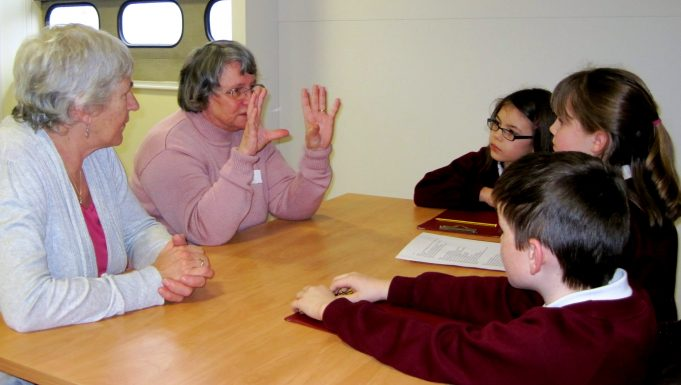 Dorothy Turner, an Editor with Hadleigh & Thundersley Community Archive, answering questions from Hadleigh Junior pupils at HOFS  | Lynda Manning