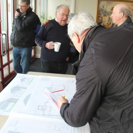 Major Geoff Ashdown talking with members of the Hadleigh Archive Group and showing the plans of proposed redevelopment of the cottages, May 2016 | Graham Cook