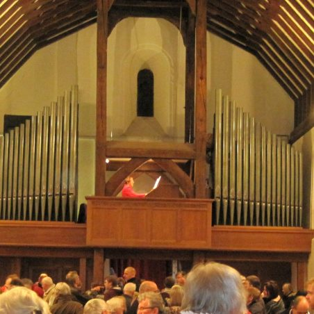 The organist - Louise Chessher - in her eyrie | Lynda Manning