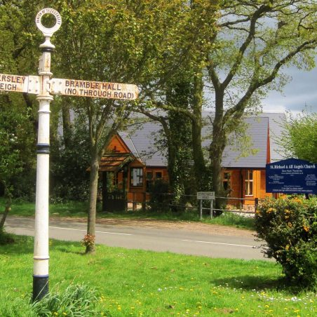 The venerable Daws Heath signpost with St Michael's in the background   Photo by Lynda Manning