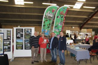 Graham Cook, Betty Sadler, Bradley Craddock and Neville Andrews with two of the the Team Hadleigh banners, these banners were on display at the castle during the olympic event in 2012. | Nick Turner