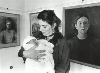 Julia and son in 1985, in front of her self portrait | By courtesy of  Newsquest Essex Echo & Gazette