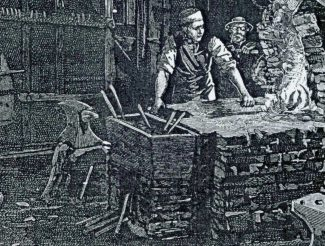 Stephen Choppen in his smithy with Cunning Murrell in the background