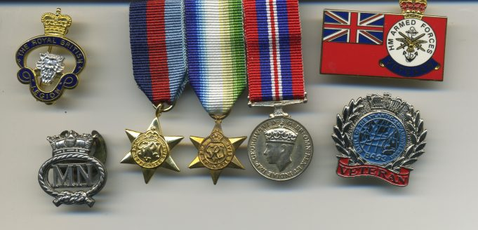 My medals from left to right: B.L.Lapel badge, 1939-1945 War Star,  Battle of the Atlantic Star,  1939 to 1945 War Medal, Merchant Navy Veterans badge, M.N. lapel badge, Battle of the Atlantic Veterans badge | Ian Hawks