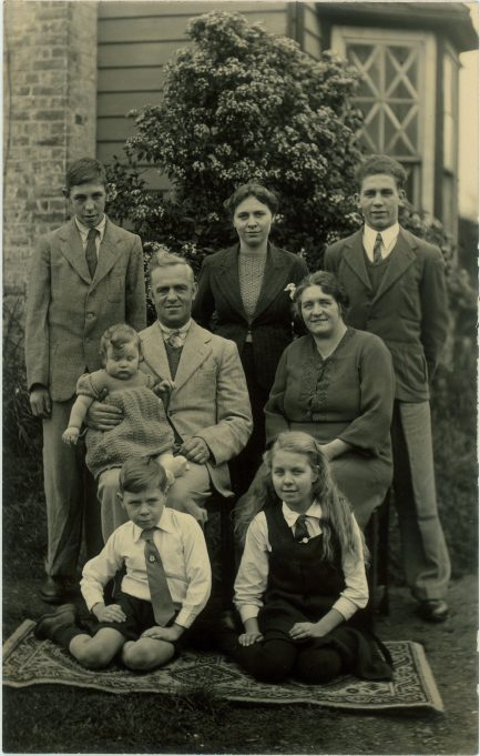 Frederick and Elizabeth Wanstall with their six children (clockwise) Leslie, Grace, Sidney, Elsie, Jimmy and Olive, pictured outside their house in Chapel Lane. Note the window taped to protect the glass from bomb blast or the nearby gun emplacements on Sayers Farm | Wanstall Family Collection