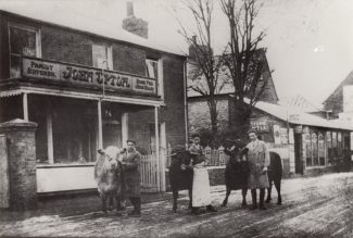 Photo of lodge as a butcher's shop and showing grocer's shop | Sandra Harvey