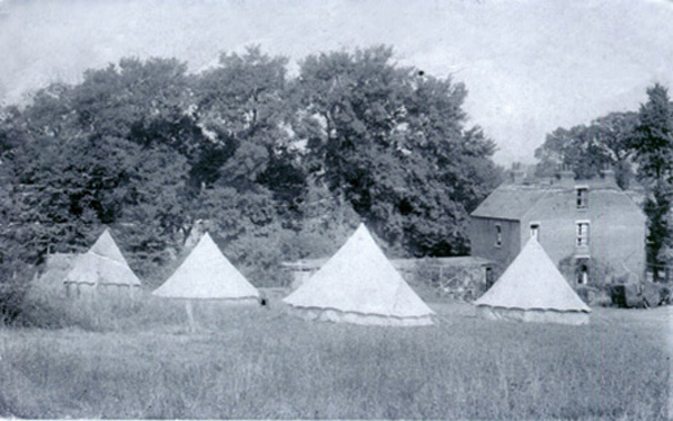 Campers from the East End of London have put up their tents behind Wheelers Rest on the fringe of rustic Thundersley. They were catered for by Mrs Ann Packham and her daughter Cissie (c.1910). | Philip Packham