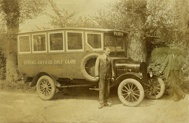 1923. Sidney Packham with one of the two dark blue buses he operated on behalf of Bowers Gifford Golf Club in 1923. Brother George is on the right. | Philip Packham