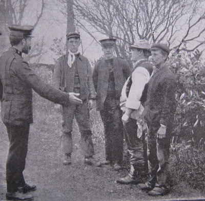 David Lamb (left) instructing some young boy farmers. | Salvation Army Archives
