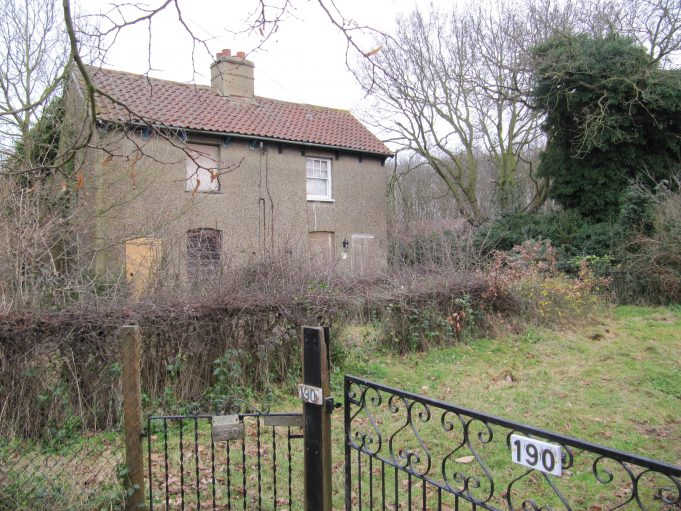 The old cottages next to Daws Heath Timber in 2011, prior to being demolished. | Graham Cook