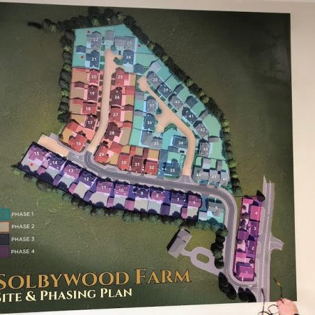 The wall plan in the Sales Office helps to understand the layout.   Graham Cook
